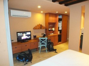 Amber Boutique Silom opposite of bed view of the room and amenities