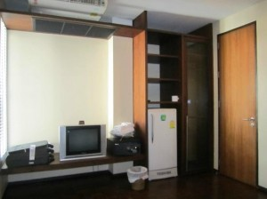 Baan Silom Soi 3 seen from the bed with TV and fridge