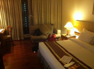 Bandara Suites Silom bedroom with sofa and tv