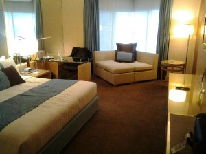 Holiday Inn Bangkok Silom bedroom with sofa