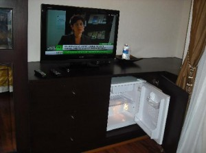 Mirth Sathorn Hotel TV and fridge in room