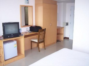 Nova Park Hotel amenities in room small TV and frige, desk