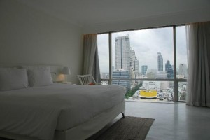 Pullman Bangkok Hotel G big bed with view of silom