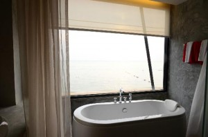 The Now Hotel tub with beach view