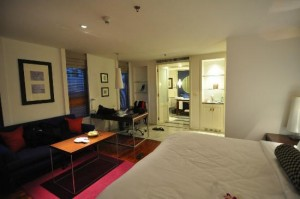 Triple Two Silom Boutique Hotel bed corner and view of the big room