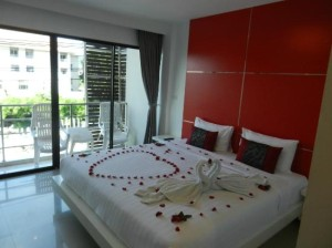 al.fres.co Phuket Hotel bedroom with balcony view